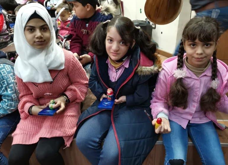 При участии Церкви детям-инвалидам в Сирии передали коляски и подарки